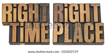 right time, right place - opportunity concept  - isolated phrase in vintage letterpress wood type - stock photo