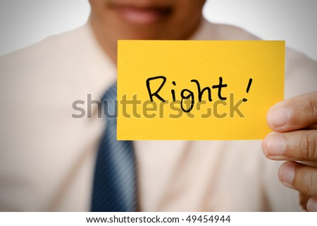 Right words card in yellow holding by businessman. - stock photo