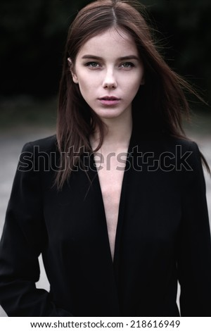 rigorous portrait of a beautiful girl in a jacket - stock photo