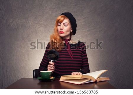 rigorous young lady looking her coffee with her magnifying glass on grunge background - stock photo