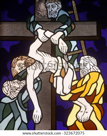 RIJEKA, CROATIA - JUNE 11: 13th Stations of the Cross, Jesus' body is removed from the cross, stained-glass window in the church of St. John the Baptist in Rijeka, Croatia, on June 11, 2011 - stock photo