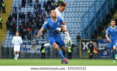 RIJEKA, CROATIA MAY 13: soccer players Josip Simunic and Lima Moises in duel  in the match NK Rijeka against NK Dinamo (Croatian Soccer Cup - the final match) on May 13, 2014 in Rijeka. - stock photo