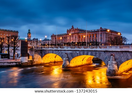 Riksdag Building and Norrbro Bridge in the Evening, Stockholm, Sweden - stock photo