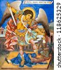 RILA, BULGARIA - JULY 8: Wall painting of St. Michael at Rila Monastery church. The monastery is the largest in Bulgaria and a UNESCO World Heritage site. July 8, 2012, Rila, Bulgaria. - stock photo