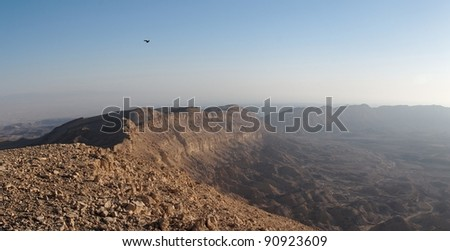 Rim of desert canyon at sunset in the Small Crater (Makhtesh Katan) in Israel's Negev desert - stock photo