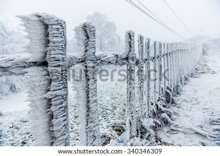 Rime covered fence by the ski-lift closed due to bad weather