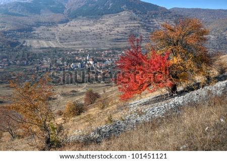 Rimetea village from Transylvania,Romania,seen from above. - stock photo