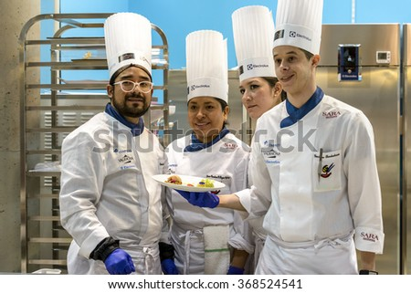 RIMINI, ITALY - 23 JANUARY 2016 - Editorial: at the fair Sigep Rimini team chef holding the plate that have just realized - stock photo