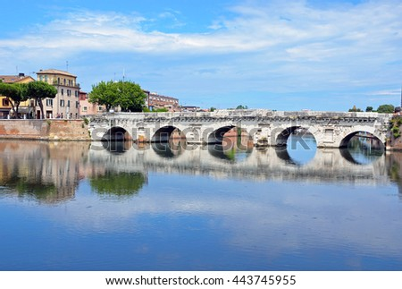 RIMINI, ITALY - JUNE 10 2016: Tiberius Bridge is a Roman bridge that features five semicircular arches and construction of it started in 14 AD and finished in 20 AD.