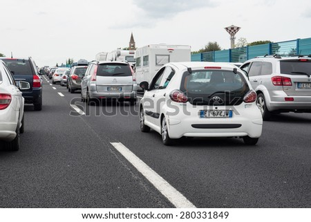 RIMINI, ITALY - MAY 2015: A traffic jam while driving to the seaside in the summer season. The A14 freeway in summertime from Bologna to Ancona register more than 200,000 vehicles a day.