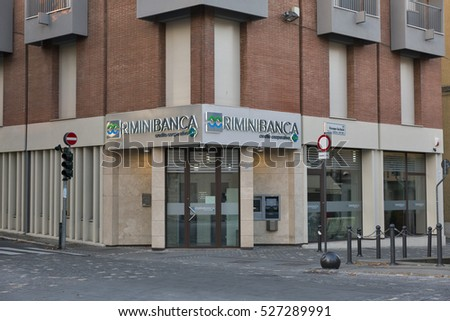 RIMINI, ITALY - SEPTEMBER 24, 2016: Facade of a RiminiBanca branch with automated teller machine. Rimini is one of the most famous Adriatic Sea resorts in Europe thanks to its 15 km long sandy beach.