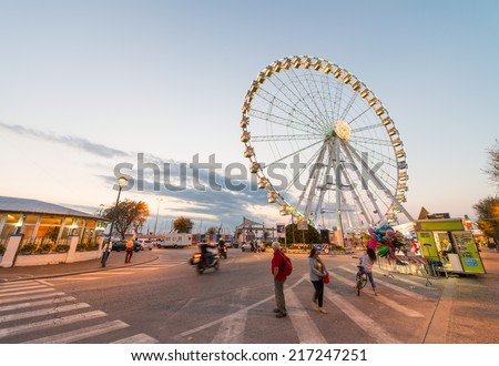 RIMINI, ITALY - SEPTEMBER 6, 2014: Night view of ferries panoramic wheel from touristic dock.