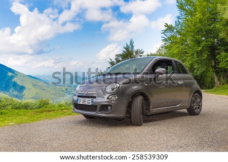 RIMONT, FRANCE - JULY 24, 2014: Fiat 500 (Type 312) parked in the French country side at Rimont in the Midi Pyrenees. The Fiat 500 hatchback is a city car built by Italian automaker Fiat since 2007. - stock photo