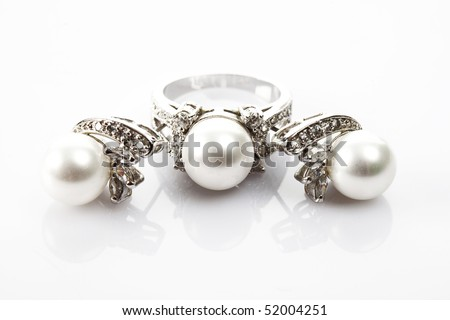 Ring and earrings with pearl - stock photo