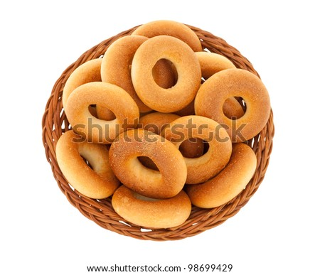 Ring bagels in basket isolated with clipping path on white background - stock photo