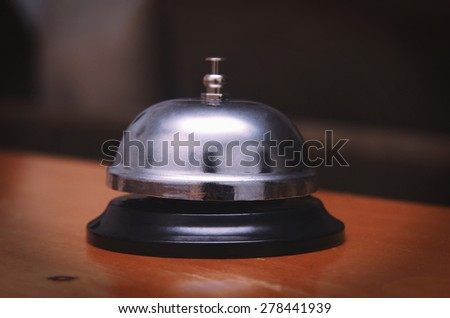 ring bell closeup on table - stock photo