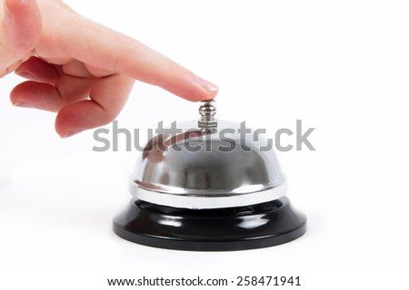 ring bell with the hand on white - stock photo