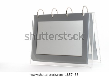 Ring binder empty photo frame, clear frame, gray, on white, seen form angle with space on left - stock photo