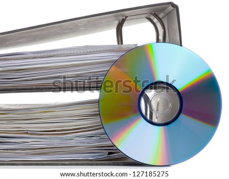 Ring binder with compact disc over white background - digital storage concept - stock photo