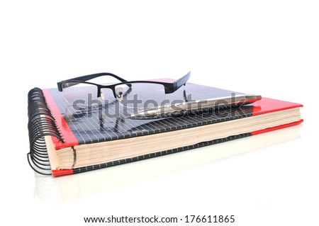 Ring binder with glasses and ball pen - stock photo