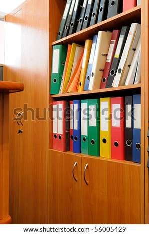 Ring binders in the storage cabinet.