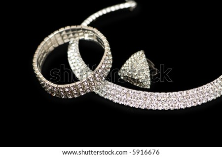 Ring, bracelet and necklace  isolated on black - more similar photos in my portfolio - stock photo