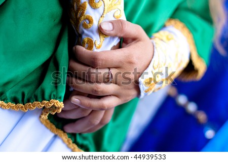 ring, hands and medieval dress