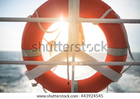 Ring life boy on big boat.Obligatory ship equipment.Personal flotation device.Prevent drowning.Orange lifesaver on the deck of a cruise ship.Traveling to an island - stock photo