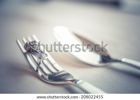 Ring newlyweds and spoon