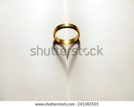 Ring on a blank book making the shape of a heart    - stock photo