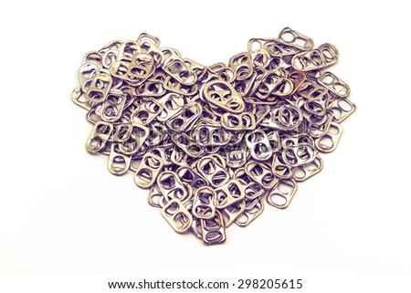 Ring pull aluminum of cans stack as heart shape indicate of new hope on white background processed in vintage style - stock photo