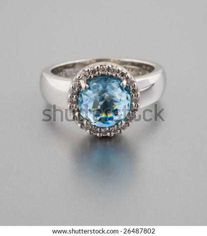 ring with blue stone - stock photo