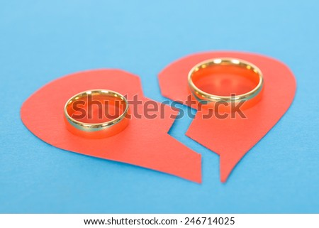 Ring With Broken Heart Over Blue Background - stock photo