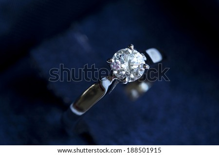 Ring with diamond into the gift box on the white background - stock photo
