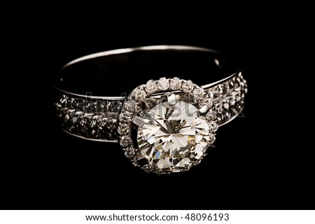 Ring with diamonds on black background. - stock photo