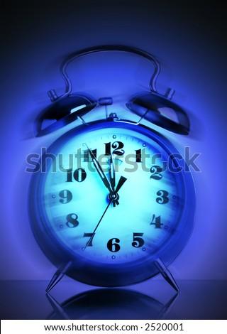 Ringing old style alarm clock (movement blur) - stock photo