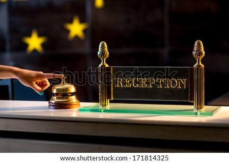 ringing the bell on the reception - stock photo