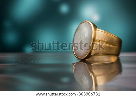 Rings newlyweds , Green Burmese Imperial Jade Ring. And art background
