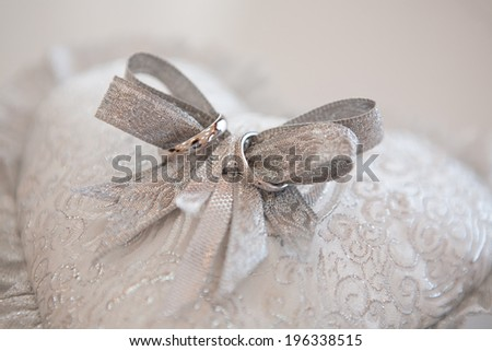 rings on the silver bow - stock photo