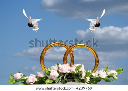 Rings symbolizing wedding on a background of the light-blue sky