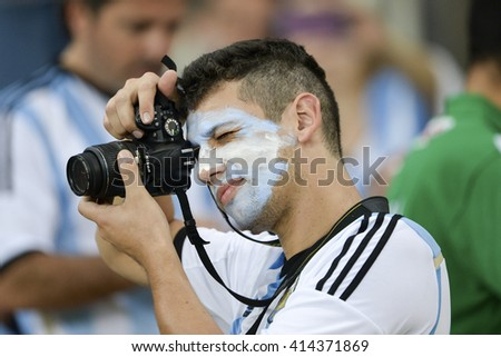 RIO, BRAZIL - June 15, 2014: Fan taking picture during the 2014 World Cup. Argentina is facing Bosnia in the Group F at Maracana Stadium