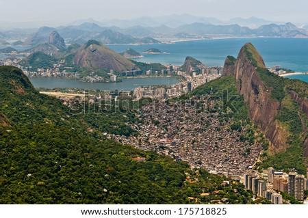 Rio de Janeiro Aerial View with Corcovado Mountain and Sugarloaf Mountain in the Horizon - stock photo