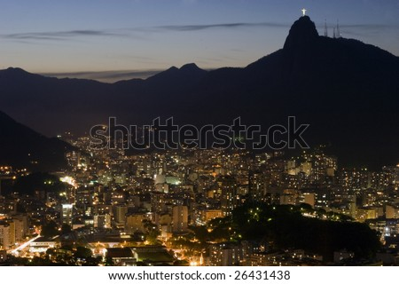 Rio de Janeiro amd Jesus Redentor by night - stock photo