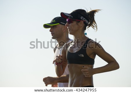 RIO DE JANEIRO - APRIL 3, 2016: Brazilian couple jogs together, a common sight in a city well-known for its fitness fanatics.  - stock photo