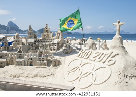 RIO DE JANEIRO - APRIL 4, 2016: Rio 2016 message made from sand topped by a model of Christ the Redeemer stands on Copacabana Beach in anticipation of the city hosting the Summer Games. - stock photo