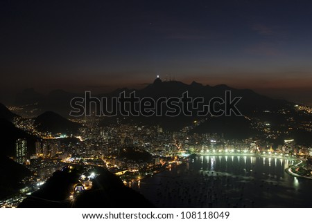 Rio de Janeiro at night, view from Sugarloaf mountain on Corcovado mountain and Christ the redeemer statue