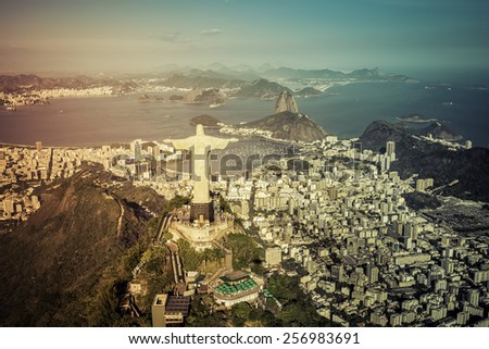 Rio de Janeiro, Brazil : Aerial view of Christ and Botafogo Bay from high angle with light leak - stock photo
