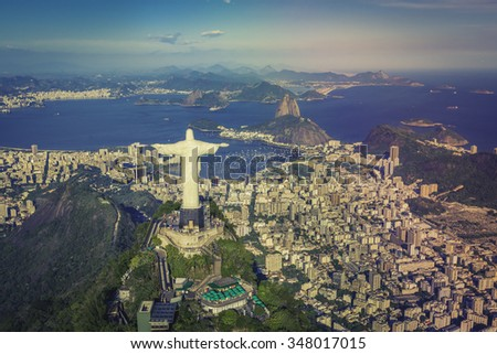 Rio de Janeiro, Brazil : Aerial view of Christ and Botafogo Bay from high angle with warm colors