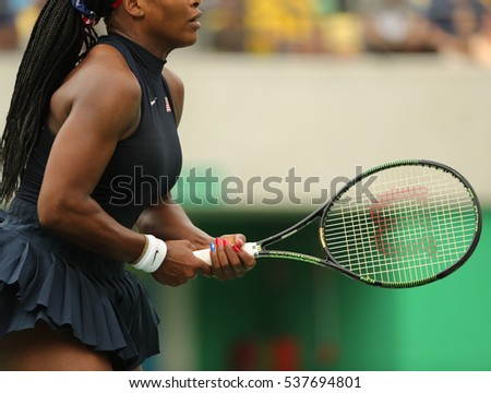 RIO DE JANEIRO, BRAZIL - AUGUST 7, 2016: Olympic champion Serena Williams of United States plays with Wilson racquet during first round match of the Rio 2016 Olympic Games at the Olympic Tennis Centre