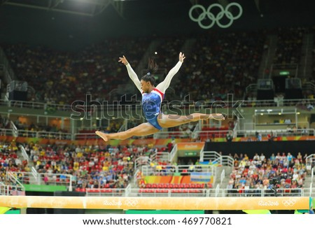 RIO DE JANEIRO, BRAZIL AUGUST 8, 2016: Olympic champion Simone Biles of United States competing on the balance beam at women's all-around gymnastics at Rio 2016 Olympic Games